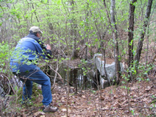 FST examines a culvert along the proposed rail trail