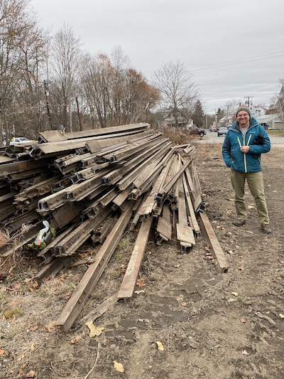 Steel rails piled near Depot St